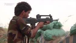 Iraqi Forces Fight Islamic State Militants For Shi'Ite Town