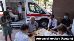 ARMENIA -- People prepare to get vaccinated against the coronavirus disease (COVID-19) at a mobile vaccination center in Yerevan, July 19, 2021