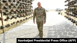 Azerbaijani President Ilham Aliyev tours Baku's Military Trophies Park, which showcases equipment seized from Armenian troops during the 2020 war over the disputed Nagorno-Karabakh region.