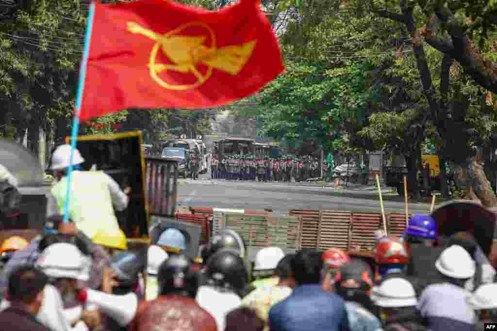 Protesters face off with police during a demonstration against the military coup in Mandalay on March 3, 2021.