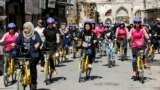 Iraqi women ride bicycles during a cycling activity in Mosul, Iraq, April 12, 2021. REUTERS/Khalid al-Mousily