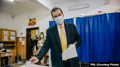 Ludovic Orban, the Romanian prime minister and leader of the National Liberal Party (PNL), casts his vote in parliamentary elections on December 6.