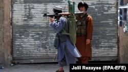 Members of private militia patrol in Herat city following intense battle with Taliban militants.