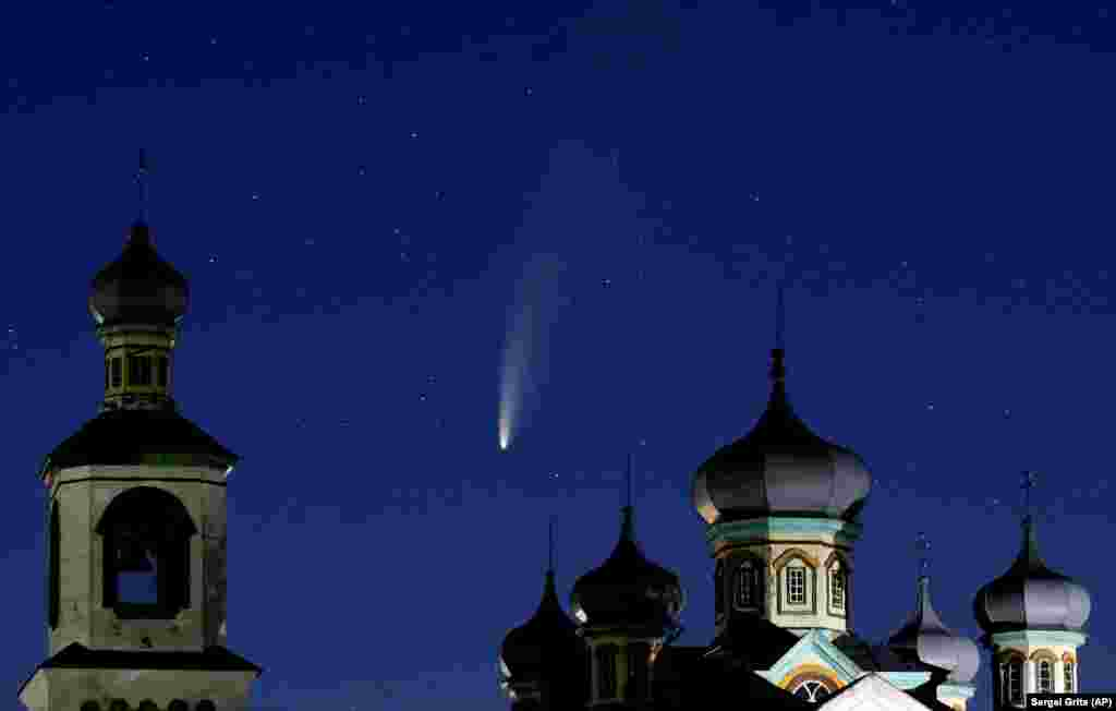 The comet Neowise is seen behind an Orthodox church west of the Belarusian capital, Minsk. (AP/Sergei Grits)
