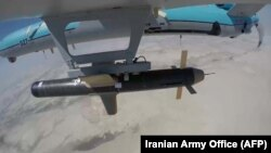 IRAN -- A handout picture provided by the Iranian Army's official website on September 11, 2020, shows an Iranian Simorgh drone carrying a weapon during the second day of a military exercise in the Gulf, near the strategic strait of Hormuz in southern Ir