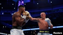 Oleksandr Usyk lands a punch on Anthony Joshua in their world title fight in London on September 25.