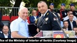 The current commander of the gendarmerie, Dejan Lukovic (right), praised Goran Radosavljevic's work as he handed him a plaque on June 30 in Novi Sad.