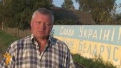 Жыхар Клецка намаляваў на сваім плоце вялізны жоўта-блакітны сьцяг