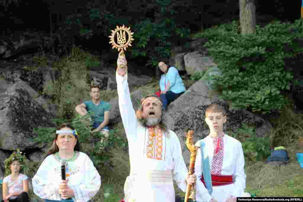 A reveler holds up a symbol of Ukraine.