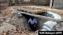 A man gets out of a makeshift bomb shelter in the village of Sahlabad outside the Azerbaijani city of Tartar on September 29.
