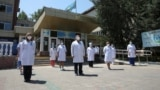 Medical personnel gather outside a hospital in Almaty on July 13 to observe a minute of silence for colleagues who died in the COVID-19 outbreak.