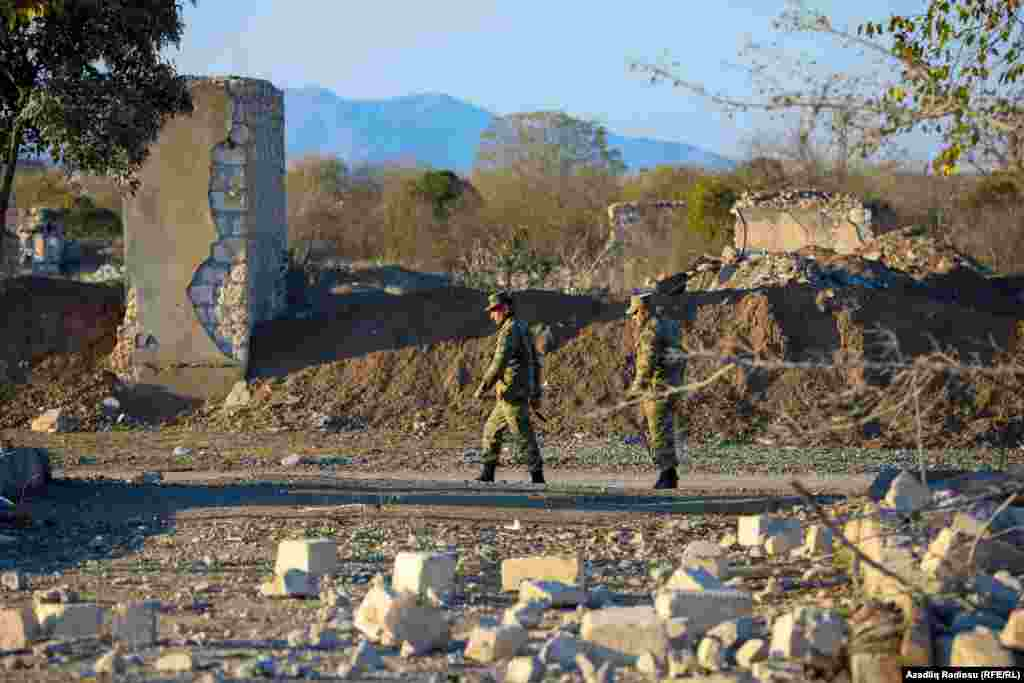 On patrol: Azerbaijani troops amid ruined buildings in Agdam.