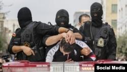 تصویری از گرداندن یک متهم در شهر تهران