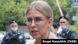 Russian opposition activist Lyubov Sobol speaks to the media as she arrives at a court in Moscow on August 3.