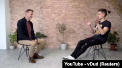 Russian opposition politician Aleksei Navalny speaks during an interview with prominent Russian YouTube blogger Yury Dud in Berlin on October 6.