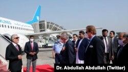Afghan envoy Abdullah Abdullah (left) arrives Islamabad on September 28.
