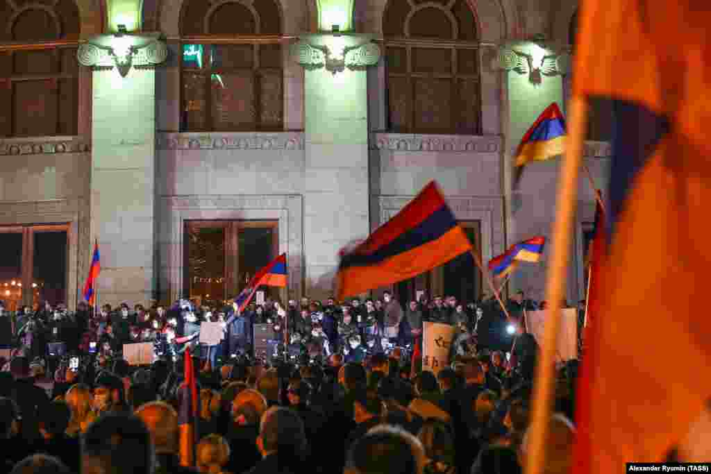 People take part in a protest on Yerevan's Freedom Square demanding Pashinian's resignation.