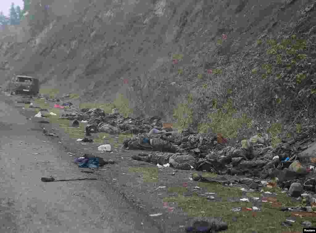 Piles of bodies on the roadside near the town of Shushi/Susa, which was captured by Azerbaijani forces on November 8. RFE/RL was not able to confirm the nationality of the dead fighters in the photographs taken from the convoy.