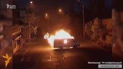 Silahlı dəstə Yerevanda polis maşınını yandırıb