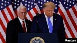 Претседателот на САД Доналд Трамп и потпретседателот Мајк Пенс.