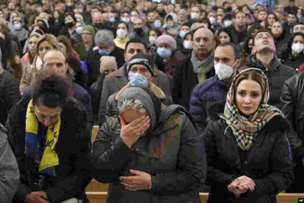 Women weep during a church service held in Yerevan on December 19.