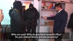 WATCH: This activist video shows a Russian police raid on the Simferopol headquarters of SimSitiTrans, a business owned by the father of Crimean Tatar activist Lenur Islyamov. Masked men carrying assault rifles refuse to answer any questions or present any ID.