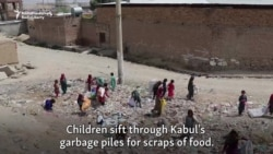 Displaced And Desperate, Afghan Kids Search Trash For Food