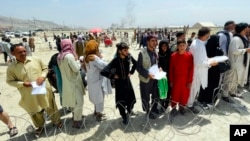 Crowds gather outside the international airport in Kabul on August 17 in the hope of getting a flight out of the country.