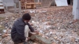 Pakistan's Bara Shopkeepers Try To Rebuild And Reopen