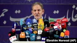 Vice President Eshaq Jahangiri speaks to the media after registering as a candidate for the presidential election at the Interior Ministry in Tehran on May 15.