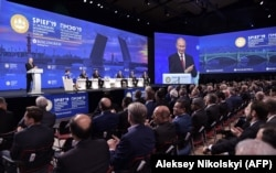 Russian President Vladimir Putin speaks at the St. Petersburg International Economic Forum on June 7. Organizers called it a celebration of Russia's exit from the pandemic.