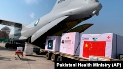 Boxes of the Chinese Sinopharm vaccine for COVID-19 are unloaded from a Pakistan Air Force plane on arrival at Nur Khan Airbase in Rawalpindi on February 1.