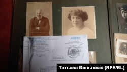 Case documents from the Mikhail Bart case with one of Kirill Gorodetsky's family albums. The photos are of Bart and his wife, Emma.