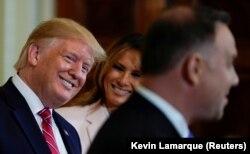 Президенты США и Польши Дональд Трамп и Анджей Дуда на переговорах в Вашингтоне год назад