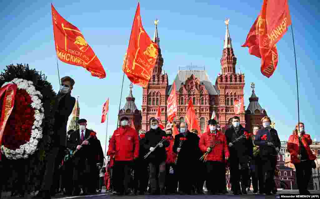 Russian communist supporters march toward the mausoleum of Vladimir Lenin to lay flowers on the 102nd anniversary of the Komsomol on Red Square in Moscow on October 28. Komsomol was the youth division of the Soviet Communist Party and was established in 1918. It died shortly after the collapse of the Soviet Union in 1991. (AFP/Alexander Nemenov)