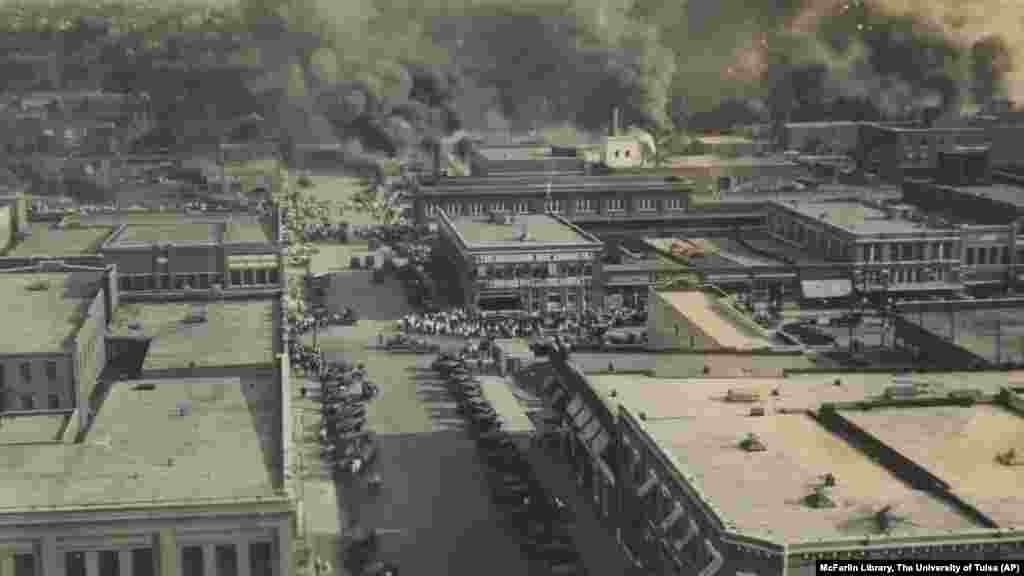 Crowds of people watching fires during the Tulsa Race Massacre in Tulsa, Okla., on June 1, 1921.