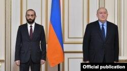 Armenia -- President Armen Sarkissian (R) and parliament speaker Ararat Mirzoyan meet in Yerevan, December 11, 2020.