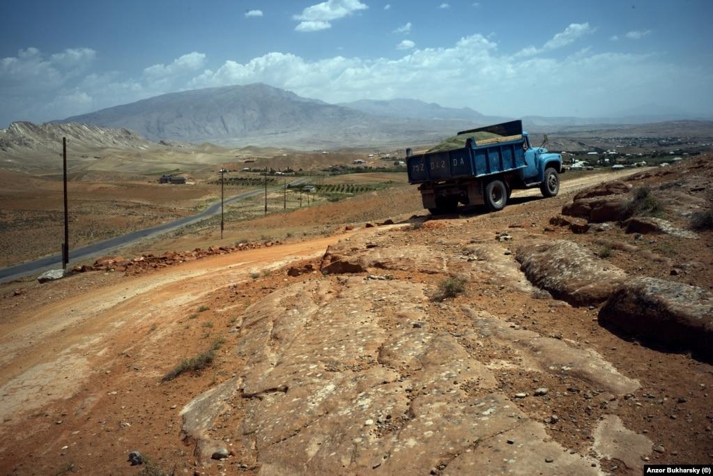 A Soviet-era truck rumbles along a dirt road in Uzbekistan's southern Surkhandarya region.