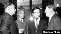 Kohzad (second left) stands with Asghar Khan (left), a high-ranking personality from Afghanistan, and two others from Uzbekistan.