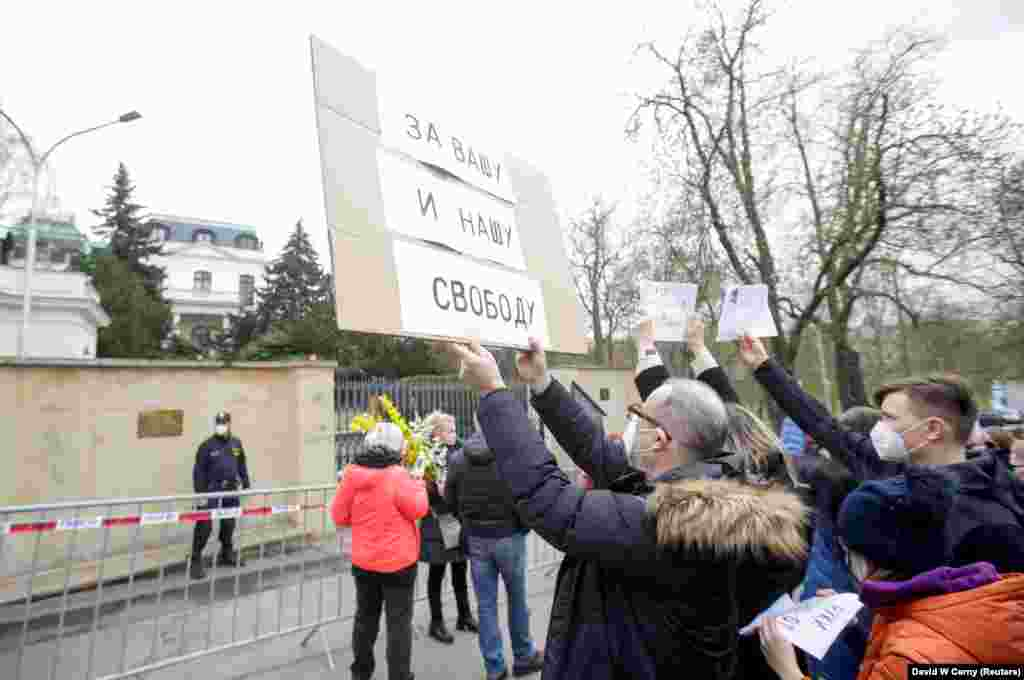 "Czechs protested the news of the alleged Russian involvement in the 2014 arms depot blast outside the Russian Embassy in Prague on April 18. The sign reads: ""For Your And Our Freedom."""
