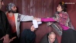 У Львові кримські татари провели флеш-моб у товарному вагоні