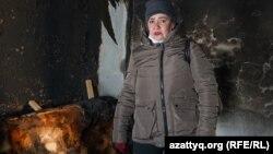 Медсестра сельского медпункта Галина Федюшко в своем доме, где произошел пожар. Село Радовка, Акмолинская область, 30 ноября 2020 года.