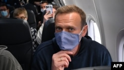 Aleksei Navalny travels on a flight back to Moscow on January 17. Analysts say a few arrests won't stop police and other law enforcement officers from monetizing their access to sensitive information.