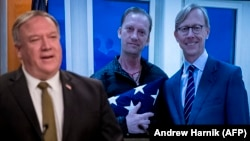 Mike Pompeo speaks while in the backdrop an image of Michael White (C), a former prisoner in Iran is seen. June 10, 2020