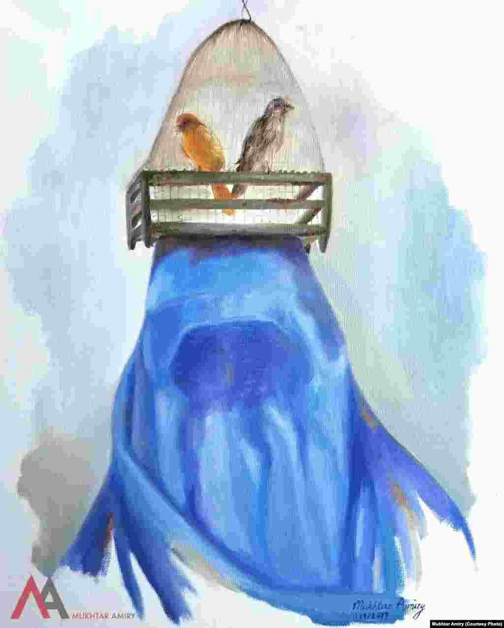 زن افغان در چادری با قفس