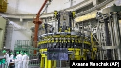 Personnel work to begin loading nuclear fuel at Belarus's first nuclear plant near Astravets on August 7.