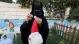 HEALTH-CORONAVIRUS/GAZA-CHRISTMAS / A Palestinian woman wearing face veil, niqab, works on a Christmas-themed doll in a handicraft workshop, amid the coronavirus disease (COVID-19) outbreak, in the northern Gaza Strip December 1, 2020