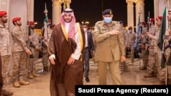 Pakistani Army Chief of Staff General Qamar Javed Bajwa is welcomed by Saudi Arabian Deputy Defense Minister Prince Khalid bin Salman, in Riyadh on August 17