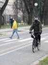 Bosnia and Herzegovina, Sarajevo, A man on a bicycle on Wilson's Promenade, April, 2021
