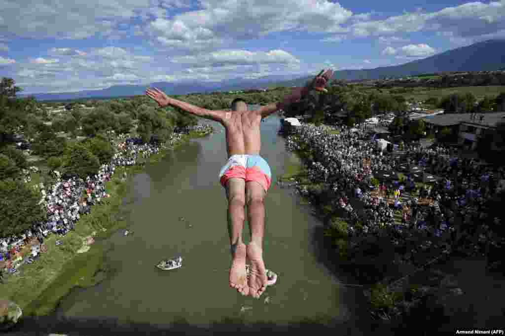 A diver jumps from the 22-meter-high bridge Ura e Shenjte in a sign of protest after Kosovar police canceled the 70th-annual high-diving competition at the bridge due to spectators failing to keep social-distancing rules. (AFP/Armend Nimani)